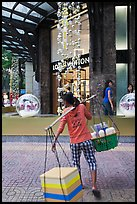 Food vendor and luxury store. Ho Chi Minh City, Vietnam (color)