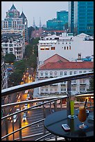 Drinks and view from rooftop bar of Hotel Caravelle. Ho Chi Minh City, Vietnam (color)