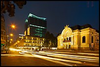 Opera house and streaks from traffic at night. Ho Chi Minh City, Vietnam (color)