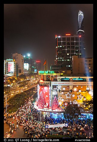 Cityscape elevated view at night with dense traffic on streets. Ho Chi Minh City, Vietnam