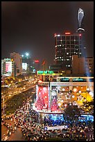 Cityscape elevated view at night with dense traffic on streets. Ho Chi Minh City, Vietnam (color)