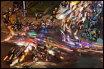 Long exposure traffic trails on busy intersection from above at night. Ho Chi Minh City, Vietnam (color)