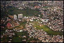 Aerial view of houses and high-rises on the outskirts of the city. Ho Chi Minh City, Vietnam ( color)