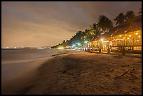 Beach bordered by resorts at night. Mui Ne, Vietnam (color)