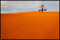Woman on top of red sand dunes. Mui Ne, Vietnam ( color)