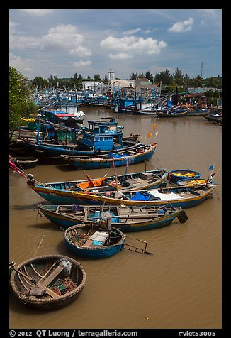 Fishing boats along river, Phan Thiet. Vietnam (color)