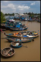 Fishing boats along river, Phan Thiet. Vietnam ( color)