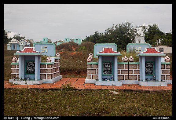 Mix of Buddhist and Christian tombs. Mui Ne, Vietnam (color)