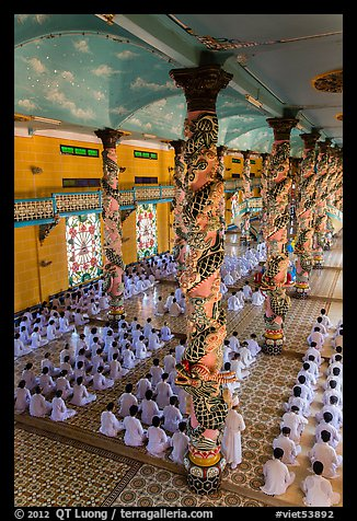 Ceremony inside Great Temple of Cao Dai. Tay Ninh, Vietnam (color)