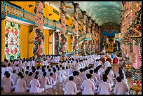 Rows of worshippers in Great Temple of Cao Dai. Tay Ninh, Vietnam (color)