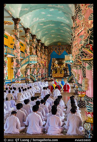 Rows of worshippers in Cao Dai Holy See. Tay Ninh, Vietnam (color)