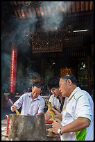 Worshippers burning incense, Thien Hau Pagoda. Cholon, District 5, Ho Chi Minh City, Vietnam (color)
