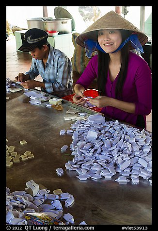 Villagers wrapping coconut candy, Phoenix Island. My Tho, Vietnam (color)