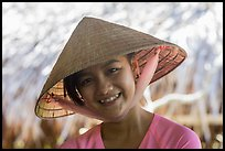 Portrait of girl with conical hat, Phoenix Island. Mekong Delta, Vietnam (color)