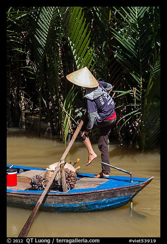 Woman standing in canoe on jungle canal, Phoenix Island. My Tho, Vietnam (color)