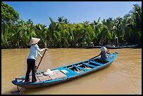 Women row canoes, Phoenix Island. My Tho, Vietnam ( color)
