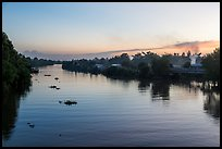 River and homes at sunset. Mekong Delta, Vietnam (color)