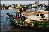 People buying fruit on boats, Cai Rang floating market. Can Tho, Vietnam ( color)