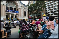 Families gather on moterbikes to watch musical performance. Ho Chi Minh City, Vietnam (color)