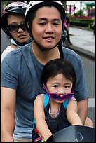 Family on motorbike with sunglasses. Ho Chi Minh City, Vietnam (color)