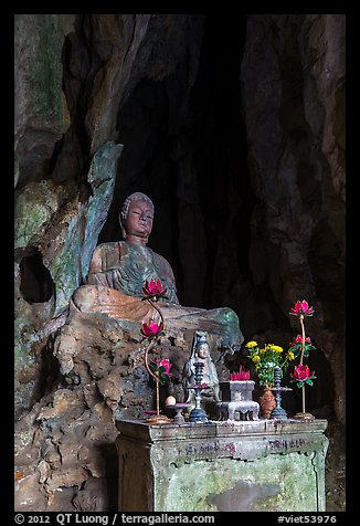 Altar and Buddha statue in grotto. Da Nang, Vietnam (color)