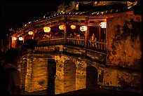 People enjoy Japanese Bridge lit solely by lanterns. Hoi An, Vietnam (color)