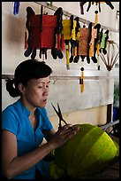 Woman working on paper lantern. Hoi An, Vietnam (color)