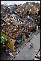 Elevated view of street with woman on bicycle. Hoi An, Vietnam (color)