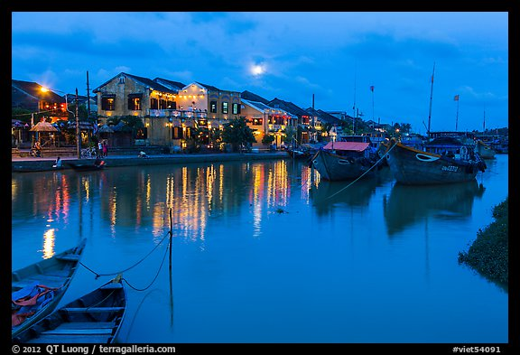 Waterfront, boats, and Thu Bon River at dusk. Hoi An, Vietnam (color)