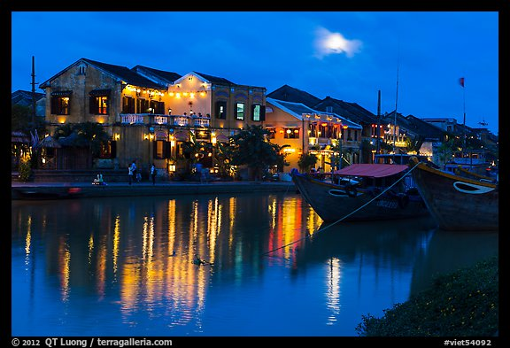 Moonrise over houses and river. Hoi An, Vietnam (color)
