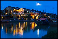 Moonrise over houses and river. Hoi An, Vietnam ( color)