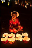 Boy with candle lanterns for sale. Hoi An, Vietnam (color)