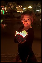 Young woman with candle box. Hoi An, Vietnam (color)
