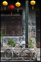 Bicycle and facade with lanterns. Hoi An, Vietnam (color)