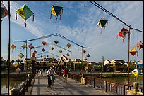 Schoolchildren cross Cam Nam bridge. Hoi An, Vietnam (color)