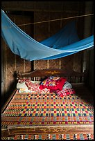 Wooden bed with straw mat and mosquito net, Cam Kim Village. Hoi An, Vietnam ( color)