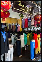 Colorful outfits and lanterns in textile shop. Hoi An, Vietnam (color)