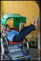Cyclo driver relaxing. Hoi An, Vietnam (color)