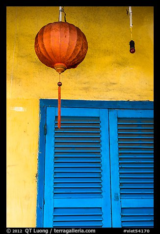 Paper lantern, wall, and blue shutters. Hoi An, Vietnam (color)