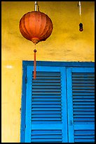 Paper lantern, wall, and blue shutters. Hoi An, Vietnam ( color)