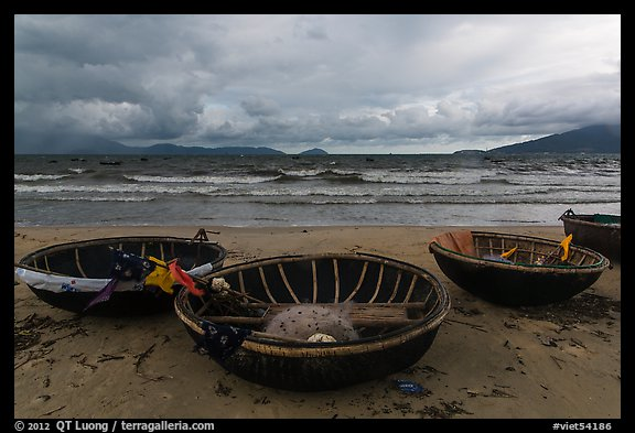 Coracle boats on beach during storm. Da Nang, Vietnam (color)