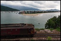 Train, bay, and village. Vietnam (color)