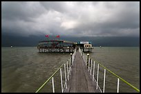 Pier leading to restaurant on stilts. Vietnam (color)