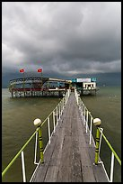 Boarwal, offshore restaurant, and threatening clouds. Vietnam (color)