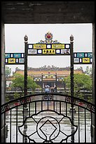Palace of Supreme Peace viewed from gate in the rain. Hue, Vietnam (color)