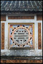 Window in the motif of Chinese symbol meaning Longevity, citadel. Hue, Vietnam (color)