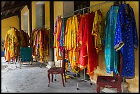 Coat hangers with silk robes in imperial style, citadel. Hue, Vietnam ( color)