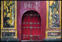 Red door and ceramic decorations, imperial citadel. Hue, Vietnam (color)