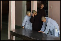 Monks looking at book, Thien Mu pagoda. Hue, Vietnam (color)