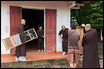 Monks carrying furniture, Thien Mu pagoda. Hue, Vietnam (color)